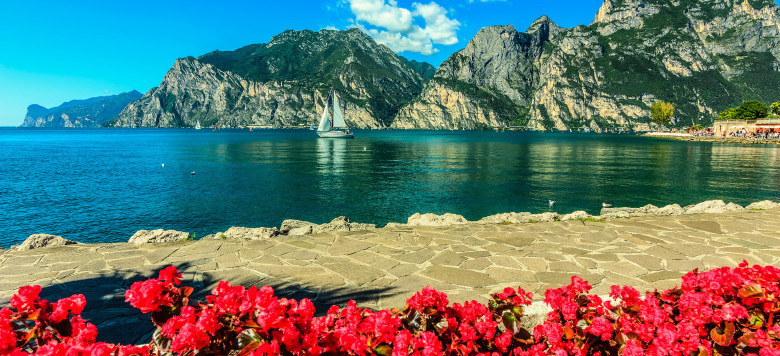 High mountains and sailing boat on the Lake Garda,Italy,Europe shutterstock_215804440-2